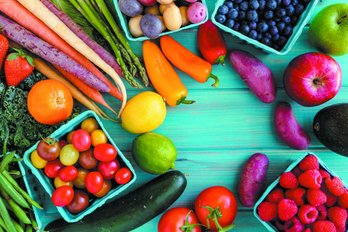 fruits and vegetables on a blue table